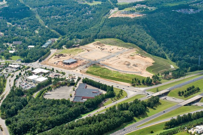 Aerial view of new Stadium Trace Village development shows construction progress